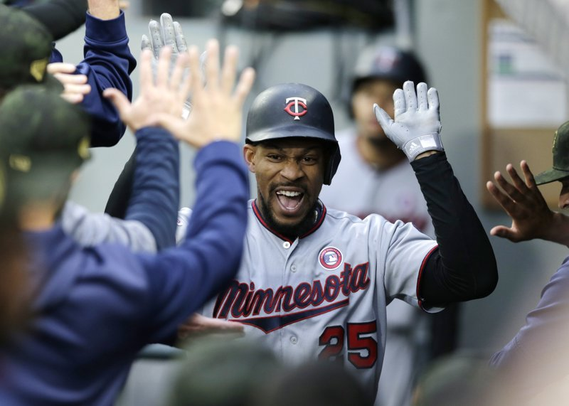 Minnesota Twins' Byron Buxton celebrates in the dugout after hitting a grand slam off Seattle Mariners' Wade LaBlanc during the second inning of a baseball game Saturday, May 18, 2019, in Seattle. (AP Photo/John Froschauer)