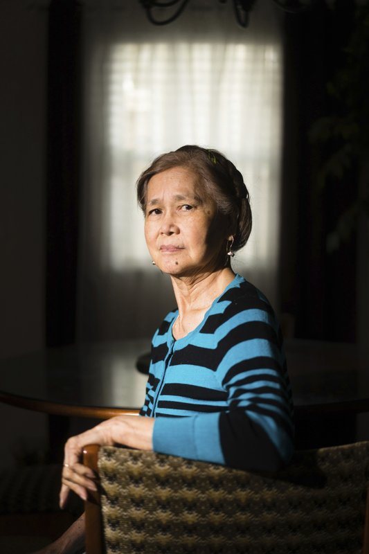 In this Friday, March 1, 2019 photo, Normita Lim poses for a photograph at her home in Concord, Calif. Lim did not receive back pay from her former employer, Publico, who paid her $2 an hour. Residential senior care homes are treating workers as indentured servants – and profiting handsomely. The profit margins can be huge and, for violators of labor laws, hinge on the widespread exploitation of thousands of caretakers, many of them poor immigrants effectively earning $2 to $3.50 an hour to work around the clock. (James Tensuan/Reveal via AP)