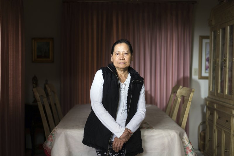 In this Friday, March 1, 2019 photo, Sonia Deza poses for a photograph at her home in Antioch, Calif. Deza worked for years as a caregiver where she earned $2 an hour from Publico. Residential senior care homes are treating workers as indentured servants – and profiting handsomely. The profit margins can be huge and, for violators of labor laws, hinge on the widespread exploitation of thousands of caretakers, many of them poor immigrants effectively earning $2 to $3.50 an hour to work around the clock. (James Tensuan/Reveal via AP)