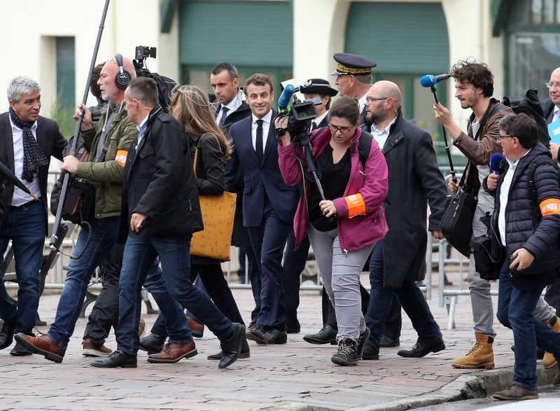 France's President Emmanuel Macron walks,during a visit to Biarritz, southwestern France, Friday, May 17, 2019. (AP Photo/Bob Edme)