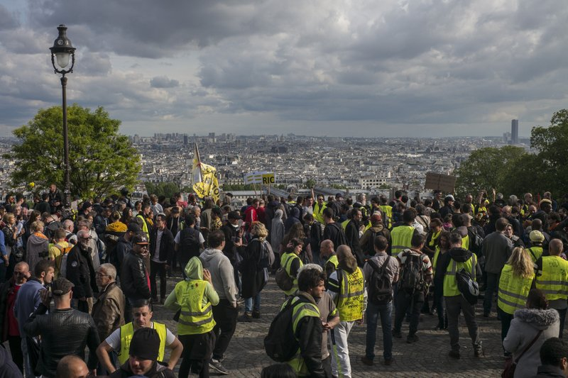 Yellow vest protestors gather in Paris, France, Saturday, May 18, 2019. Yellow vest protests are taking place for the 27th consecutive week to challenge President Emmanuel Macron's economic policies. (AP Photo/Rafael Yahgobzadeh)