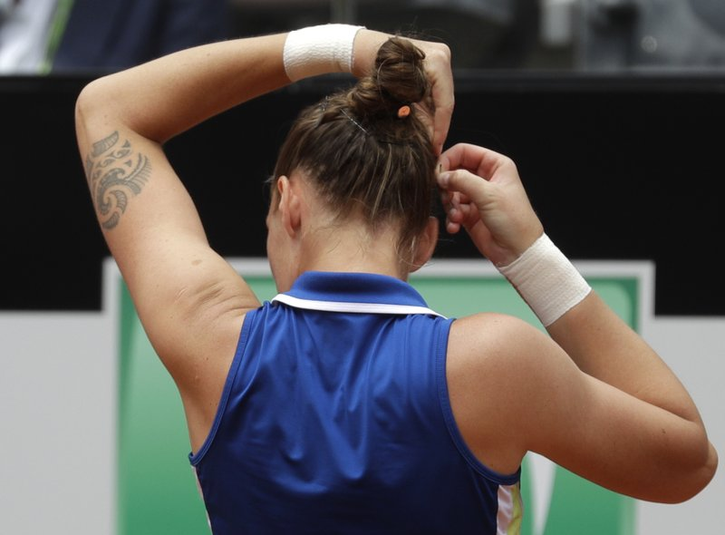 Karolina Pliskova, of the Czech Republic, adjusts an hairpin before her match against Johanna Konta, of Britain during their final match at the Italian Open tennis tournament, in Rome, Sunday, May 19, 2019. (AP Photo/Gregorio Borgia)