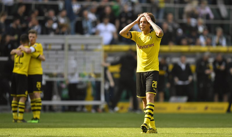 Dortmund's Axel Witsel reacts after the German Bundesliga soccer match between Borussia Moenchengladbach and Borussia Dortmund in Moenchengladbach, Germany, Saturday, May 18, 2019. Dortmund finished the season on the second place behind Bayern Munich. (AP Photo/Martin Meissner)