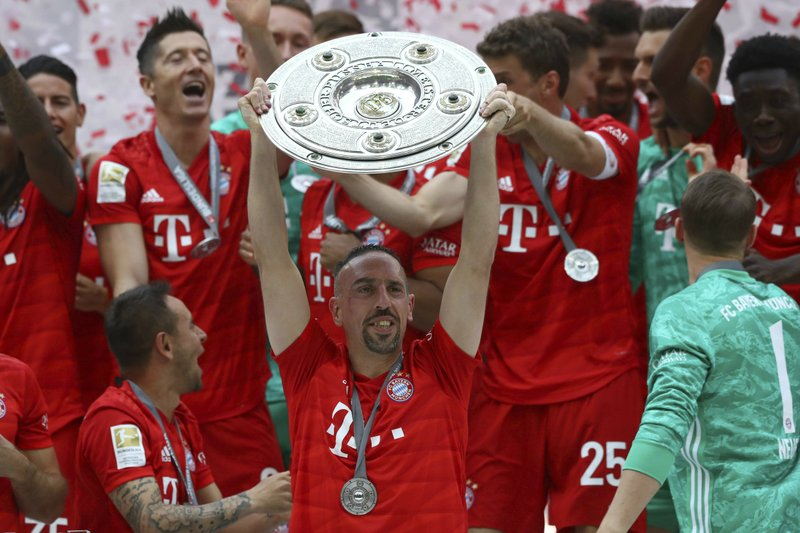 CORRECTS NAME OF OPPONENT TEAM -- Bayern's Franck Ribery lifts the trophy to celebrate Bayern's 7th straight Bundesliga title after the German Soccer Bundesliga match between FC Bayern Munich and Eintracht Frankfurt in Munich, Germany, Saturday, May 18, 2019. (AP Photo/Matthias Schrader)