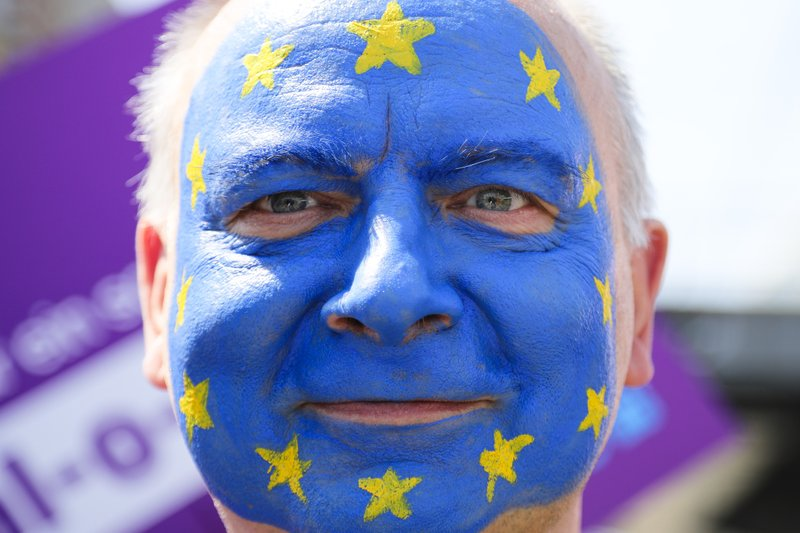 A man with his face painted like a European flag, attends a demonstration in Berlin, Germany, Sunday, May 19, 2019. People across Europe attend demonstrations under the slogan 'A Europe for All - Your Voice Against Nationalism'. (AP Photo/Markus Schreiber)