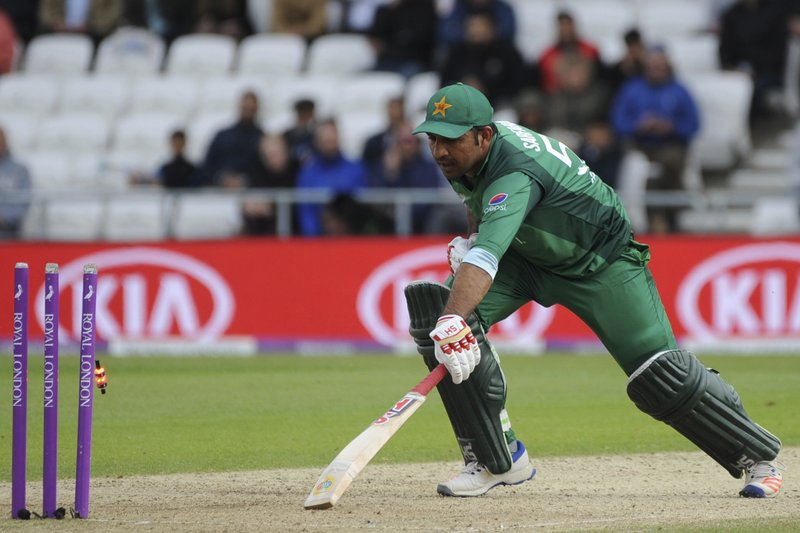 Pakistan's Sarfaraz Ahmed is run out by England's Jos Butler during the Fifth One Day International cricket match between England and Pakistan at Emerald Headingley in Leeds, England, Sunday, May 19, 2019. (AP Photo/Rui Vieira)