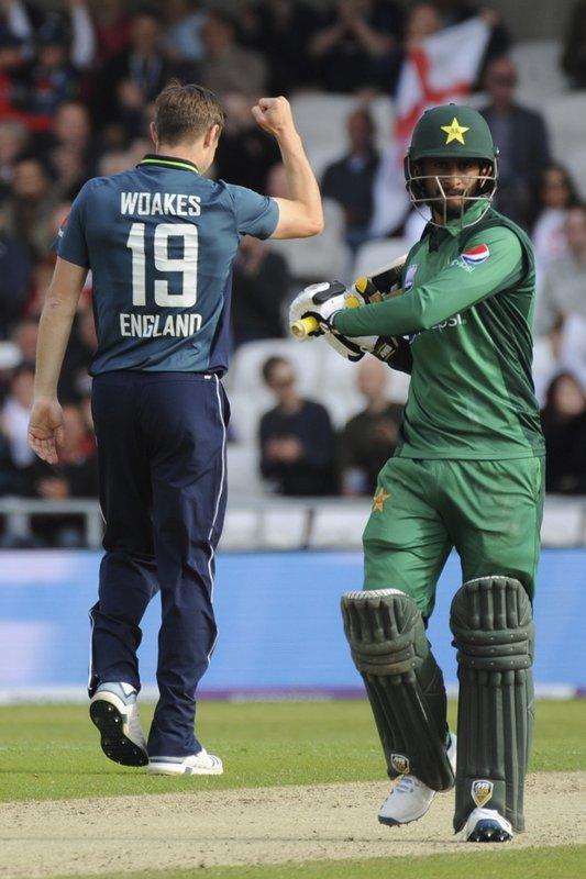 England's Chris Woakes celebrates taking the wicket of Pakistan's Hassan Ali, right, during the Fifth One Day International cricket match between England and Pakistan at Emerald Headingley in Leeds, England, Sunday, May 19, 2019. (AP Photo/Rui Vieira)