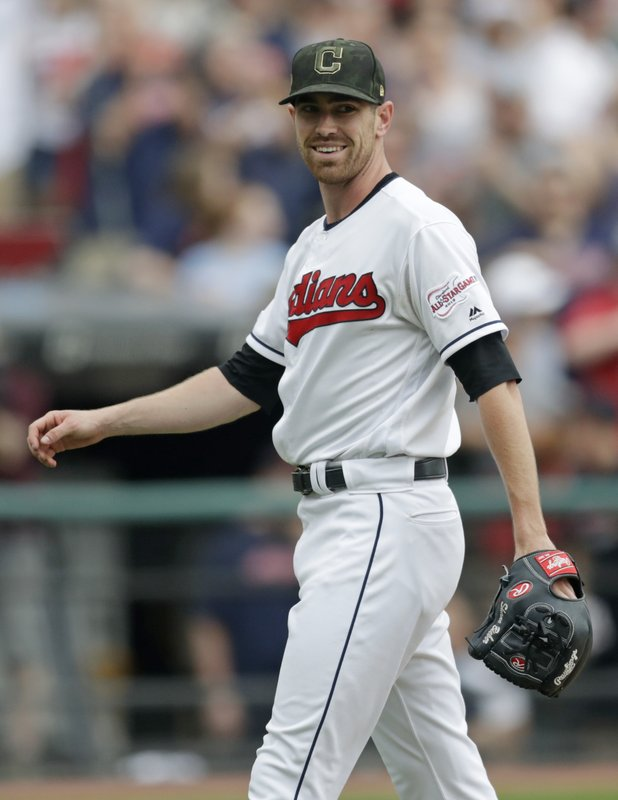 Cleveland Indians starting pitcher Shane Bieber smiles after the Indians defeated the Baltimore Orioles 10-0 in a baseball game, Sunday, May 19, 2019, in Cleveland. (AP Photo/Tony Dejak)