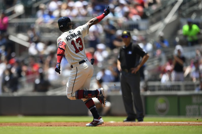 Atlanta Braves' Ronald Acuna Jr. motions to fans as he runs the bases during his home run in the first inning of a baseball game against the Milwaukee Brewers, Sunday, May 19, 2019, in Atlanta. (AP Photo/John Amis)