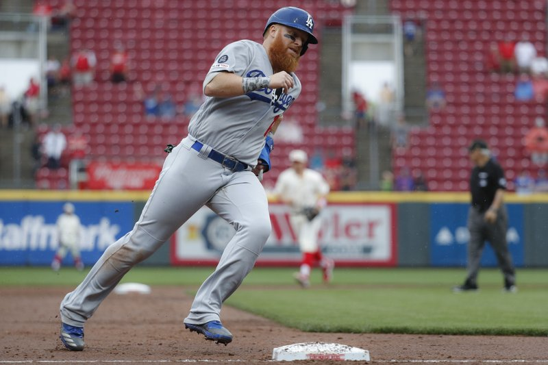 Los Angeles Dodgers' Justin Turner runs home to score on a two-run double by Alex Verdugo off Cincinnati Reds relief pitcher Robert Stephenson in the ninth inning of a baseball game, Sunday, May 19, 2019, in Cincinnati. (AP Photo/John Minchillo)
