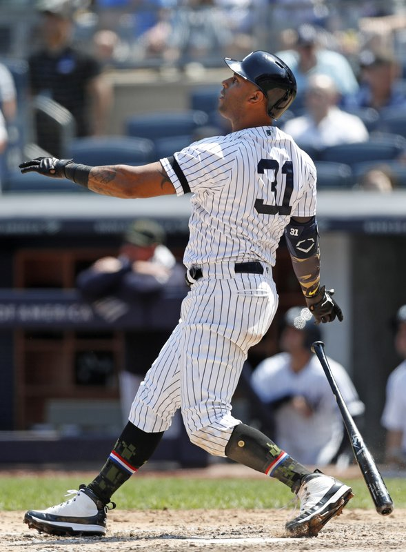 New York Yankees' Aaron Hicks watches his fourth-inning, two-run home run in a baseball game against the Tampa Bay Rays, Sunday, May 19, 2019, in New York. (AP Photo/Kathy Willens)