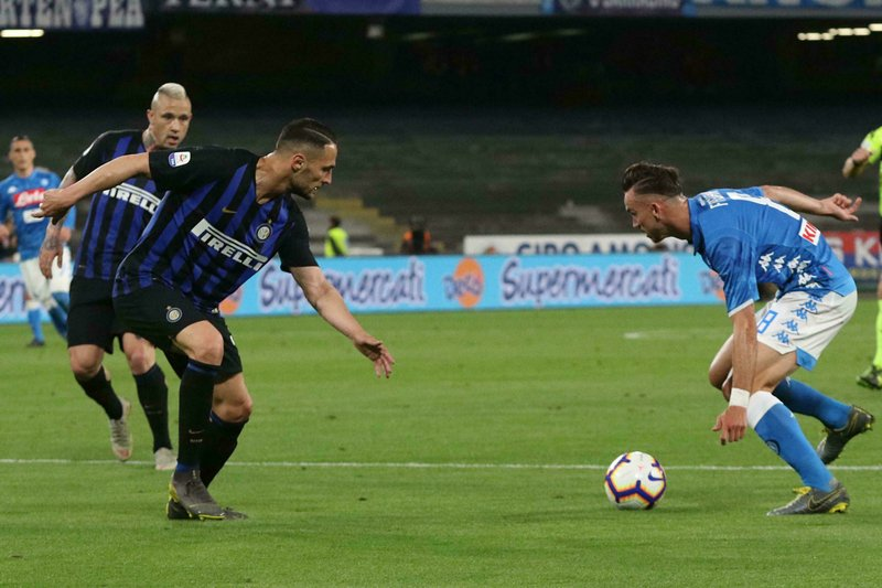 S.S.C. Napoli midfielder Fabian Ruiz, right, moves with the ball during a Serie A soccer match against Inter FC at the San Paolo stadium in Naples, Italy, Sunday, May 19, 2019. (Cesare Abbate/ANSA via AP)