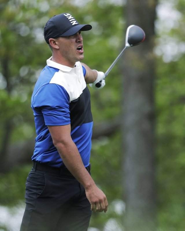 Brook Koepka reacts to his shot off the 12th tee during the final round of the PGA Championship golf tournament, Sunday, May 19, 2019, at Bethpage Black in Farmingdale, N.Y. (AP Photo/Julio Cortez)