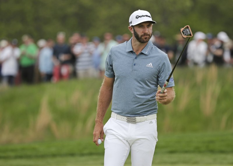 Dustin Johnson walks off the 12th green during the final round of the PGA Championship golf tournament, Sunday, May 19, 2019, at Bethpage Black in Farmingdale, N.Y. (AP Photo/Seth Wenig)