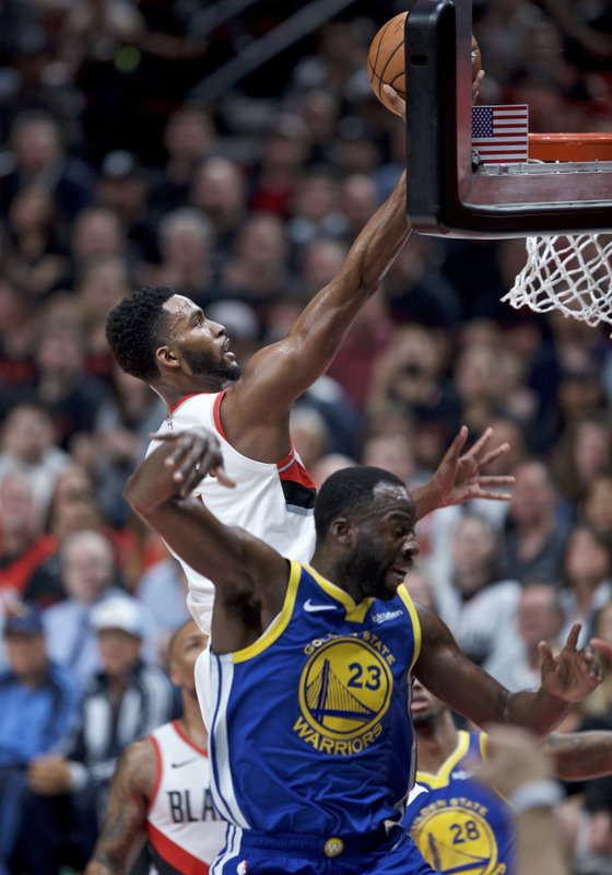 Portland Trail Blazers forward Maurice Harkless, top, shoots over Golden State Warriors forward Draymond Green during the first half of Game 3 of the NBA basketball playoffs Western Conference finals Saturday, May 18, 2019, in Portland, Ore. (AP Photo/Craig Mitchelldyer)
