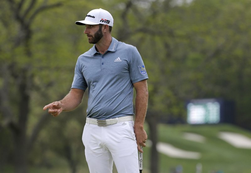 Dustin Johnson reacts after a putt on the 17th green during the final round of the PGA Championship golf tournament, Sunday, May 19, 2019, at Bethpage Black in Farmingdale, N.Y. (AP Photo/Seth Wenig)