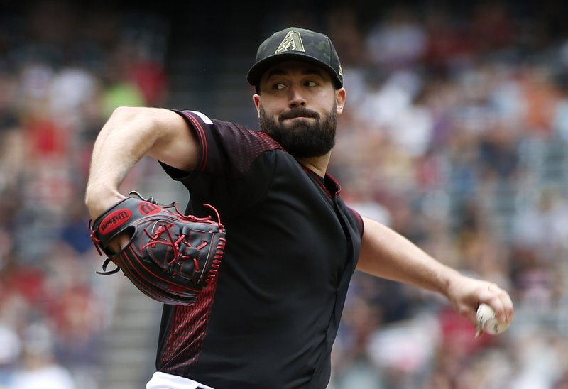 Arizona Diamondbacks starting pitcher Robbie Ray throws against the San Francisco Giants during the first inning of a baseball game, Sunday, May 19, 2019, in Phoenix. (AP Photo/Ralph Freso)