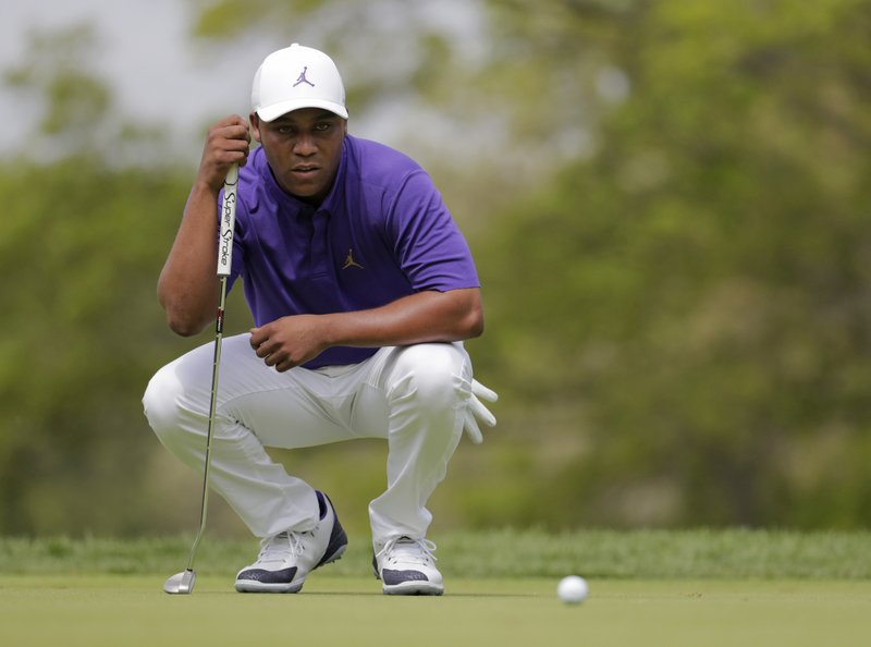 Harold Varner III lines up a putt on the third hole during the final round of the PGA Championship golf tournament, Sunday, May 19, 2019, at Bethpage Black in Farmingdale, N.Y. (AP Photo/Julio Cortez)
