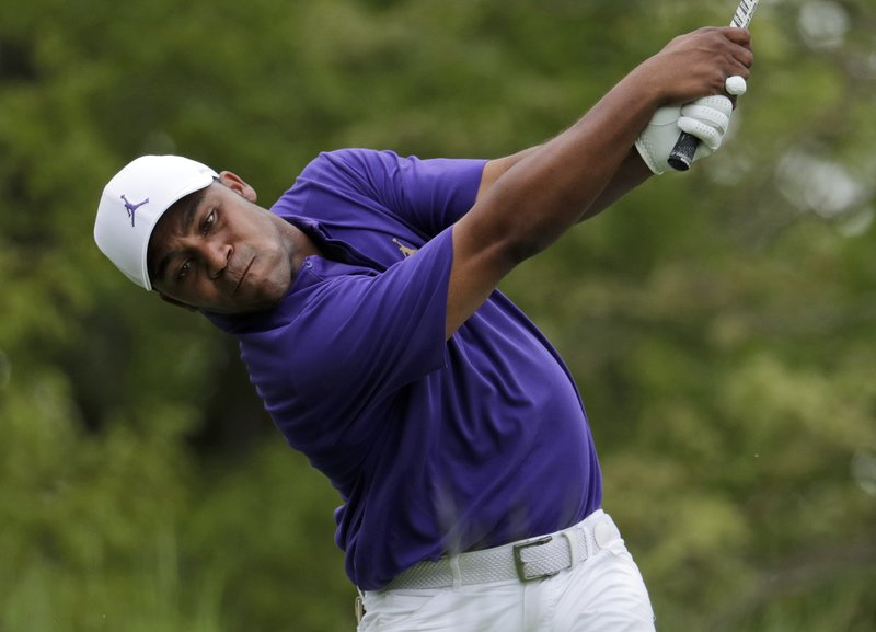 Harold Varner drives off the seventh tee during the final round of the PGA Championship golf tournament, Sunday, May 19, 2019, at Bethpage Black in Farmingdale, N.Y. (AP Photo/Julio Cortez)