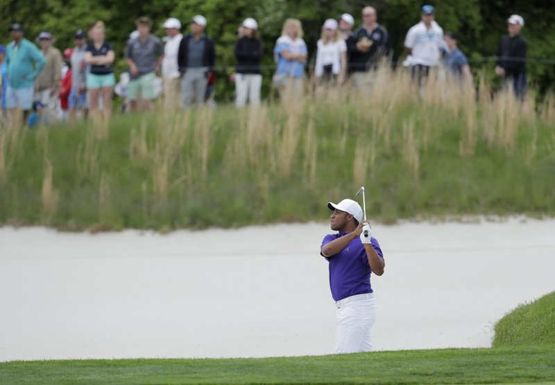 Harold Varner III hits out of a bunker on the 11th hole during the final round of the PGA Championship golf tournament, Sunday, May 19, 2019, at Bethpage Black in Farmingdale, N.Y. (AP Photo/Julio Cortez)