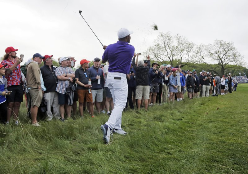 Harold Varner III hits out of the rough on the 16th hole during the final round of the PGA Championship golf tournament, Sunday, May 19, 2019, at Bethpage Black in Farmingdale, N.Y. (AP Photo/Julio Cortez)