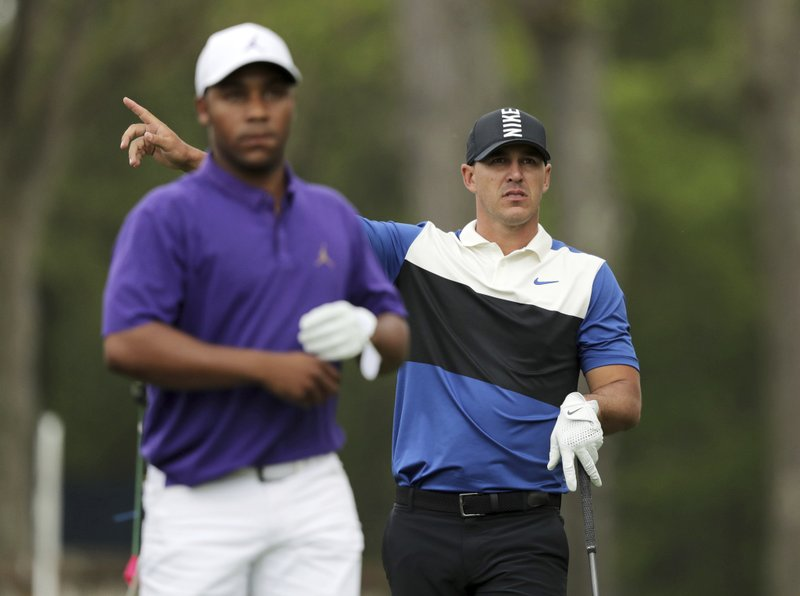 Brooks Keopka motions to the direction of his shot off the 12th tee as Harold Varner III looks on during the final round of the PGA Championship golf tournament, Sunday, May 19, 2019, at Bethpage Black in Farmingdale, N.Y. (AP Photo/Charles Krupa)