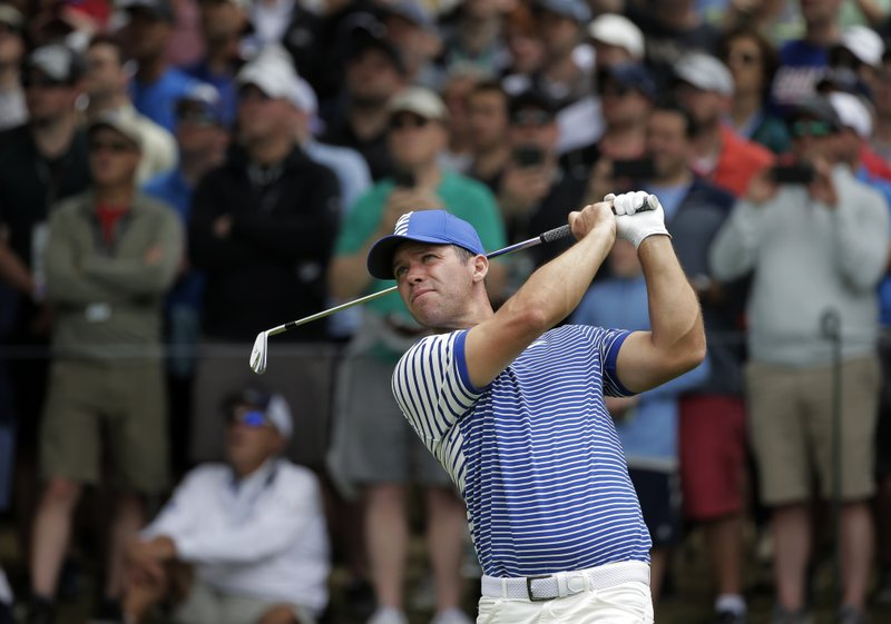 Paul Casey of England hits off the 17th tee during the final round of the PGA Championship golf tournament, Sunday, May 19, 2019, at Bethpage Black in Farmingdale, N.Y. (AP Photo/Seth Wenig)