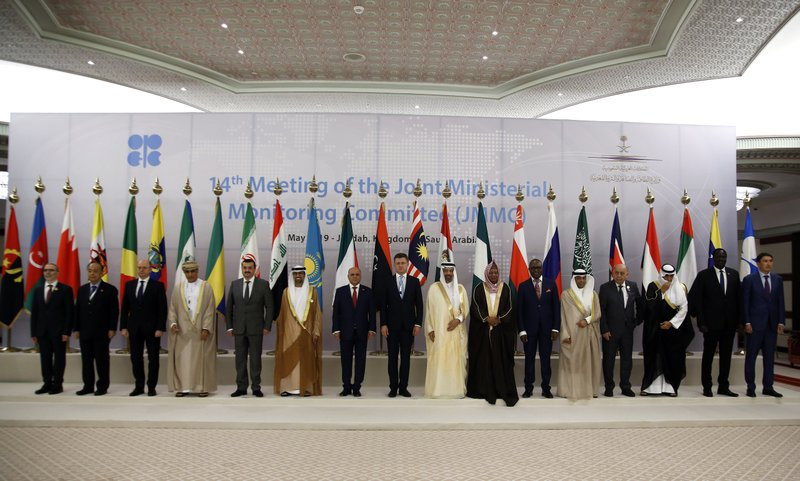 Energy ministers from OPEC and its allies pose for a group picture before they discuss prices and production cuts, in Jiddah, Saudi Arabia, Sunday, May 19, 2019. The meeting takes places as tensions flare in the Persian Gulf after the U.S. ordered bombers and an aircraft carrier to the region over an unexplained threat they perceive from Iran, which comes a year after the U.S. unilaterally pulled out of Tehran's nuclear deal with world powers and reimposed sanctions on Iranian oil. (AP Photo/Amr Nabil)