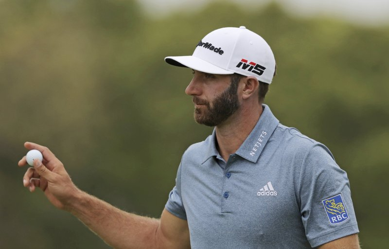 Dustin Johnson reacts after sinking a putt for birdie on the ninth hole during the final round of the PGA Championship golf tournament, Sunday, May 19, 2019, at Bethpage Black in Farmingdale, N.Y. (AP Photo/Charles Krupa)