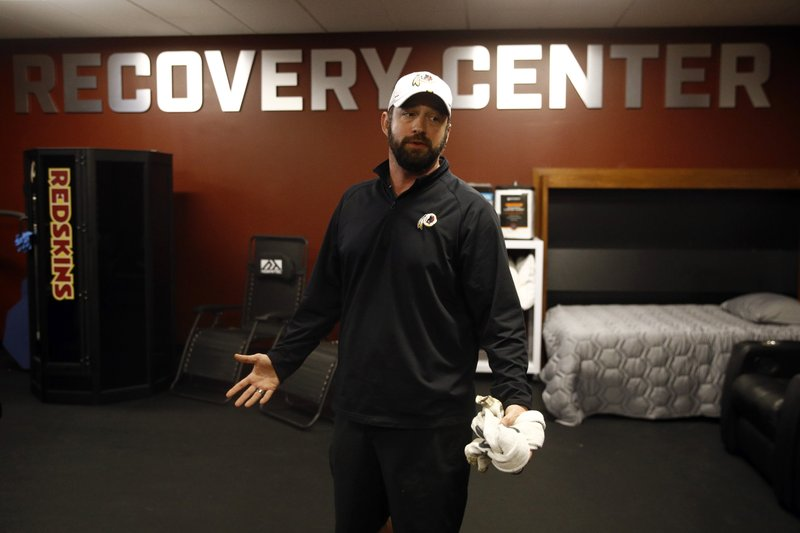 In this April 12, 2019, photo, Washington Redskins head athletic trainer Larry Hess leads a tour of a recovery room at the team's NFL football training facility in Ashburn, Va. (AP Photo/Patrick Semansky)