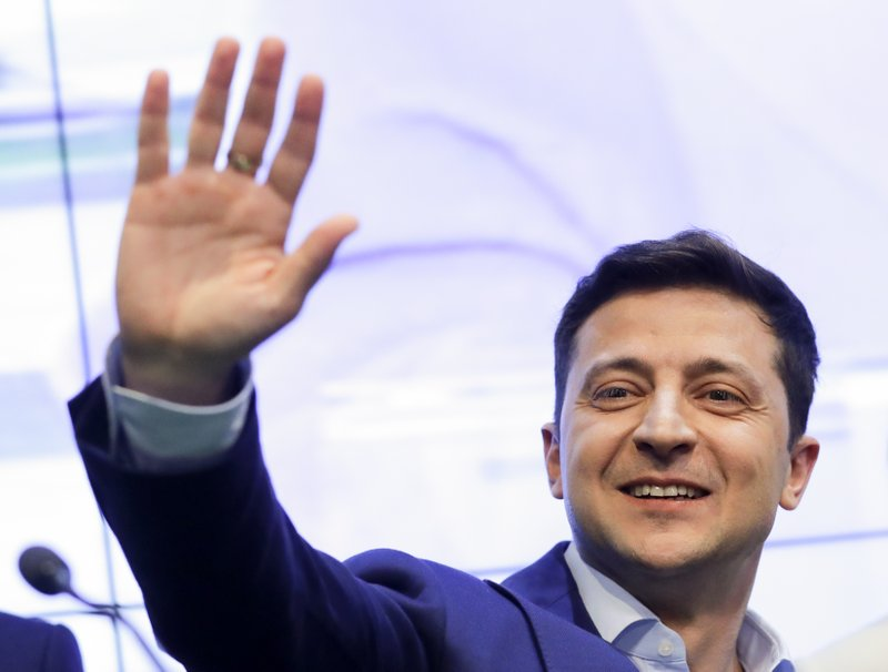 FILE - In this Sunday, April 21, 2019 file photo, Ukrainian comedian and presidential candidate Volodymyr Zelenskiy greets his supporters at his headquarters after the second round of presidential elections in Kiev, Ukraine. Volodymyr Zelenskiy, who takes the presidential oath on Monday May 20, 2019, comes into the post having never held political office; his popularity is rooted in playing the role of president on a television sit-com. (AP Photo/Sergei Grits, File)