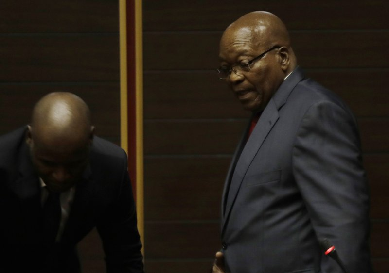 Former South African President Jacob Zuma, right, in the High Court in Pietermaritzburg, South Africa, Monday May 20, 2019. Zuma is appearing for four days this week seeking a stay of prosecution on charges of corruption. (AP Photo/Themba Hadebe, Pool)
