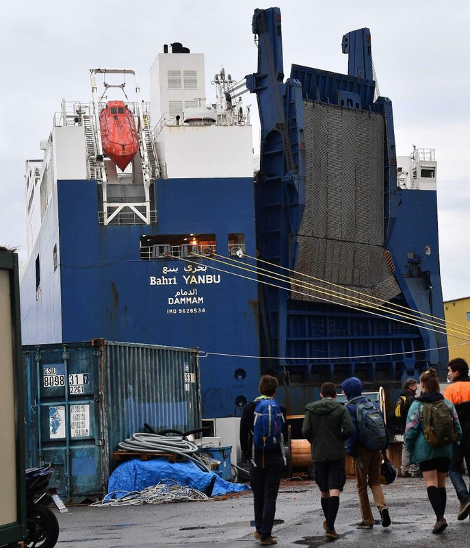 Saudi Arabian freighter Bahri Yambu is docked in Genoa's port, Italy, Monday, May 20, 2019. The freighter allegedly carrying weapons that could be used in the war in Yemen is scheduled to load further cargo before departing for the Saudi port of Jeddah late Monday despite protests by harbor workers, according to the Italian news agencies. (Luca Zennaro/ANSA via AP)