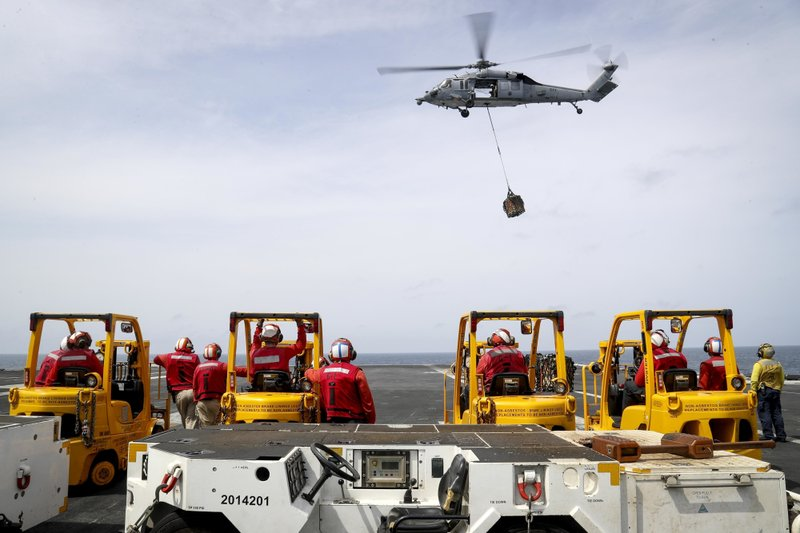 In this Sunday, May 19, 2019, photo released by the U.S. Navy, an MH-60S Sea Hawk helicopter from the