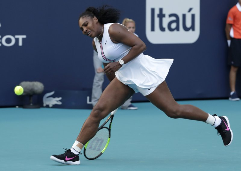 FILE - In this March 22, 2019, file photo, Serena Williams can't get to a ball hit by Rebecca Peterson, of Sweden, during the Miami Open tennis tournament in Miami Gardens, Fla. With the French Open set to start Sunday, May 26, the 10th-ranked Williams has played only nine matches in 2019. The tennis world can't wait to find out exactly how that bothersome left knee is holding up. (AP Photo/Lynne Sladky, File)