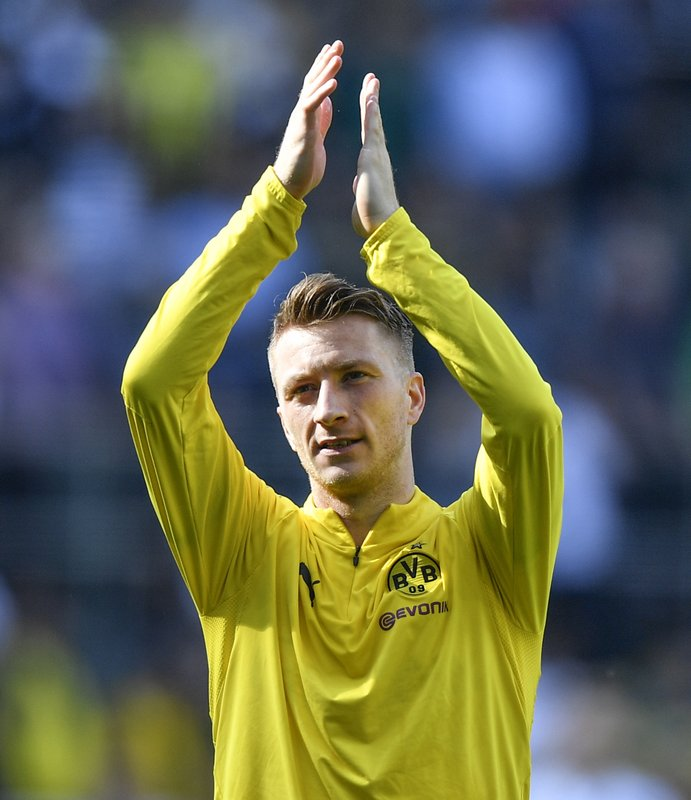 Dortmund's Marco Reus claps hands after the German Bundesliga soccer match between Borussia Moenchengladbach and Borussia Dortmund in Moenchengladbach, Germany, Saturday, May 18, 2019. Dortmund finished the season on the second place behind Bayern Munich. (AP Photo/Martin Meissner)