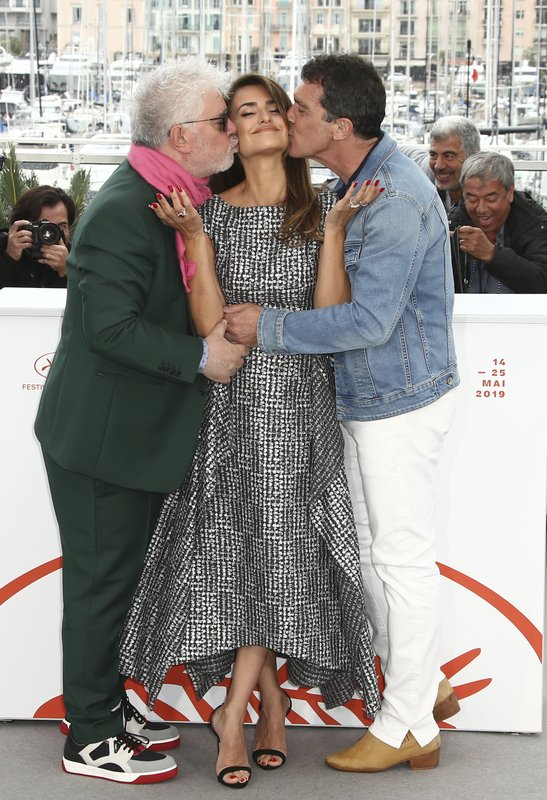 Director Pedro Almodovar, from left, actors Penelope Cruz and Antonio Banderas pose for photographers at the photo call for the film 'Pain and Glory' at the 72nd international film festival, Cannes, southern France, Saturday, May 18, 2019. (Photo by Joel C Ryan/Invision/AP)