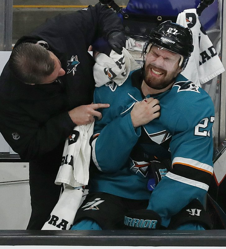 San Jose Sharks' Joonas Donskoi (27) gets medical attention on the bench in the third period in Game 5 of the NHL hockey Stanley Cup Western Conference finals against the St. Louis Blues in San Jose, Calif., on Sunday, May 19, 2019. (AP Photo/Josie Lepe)