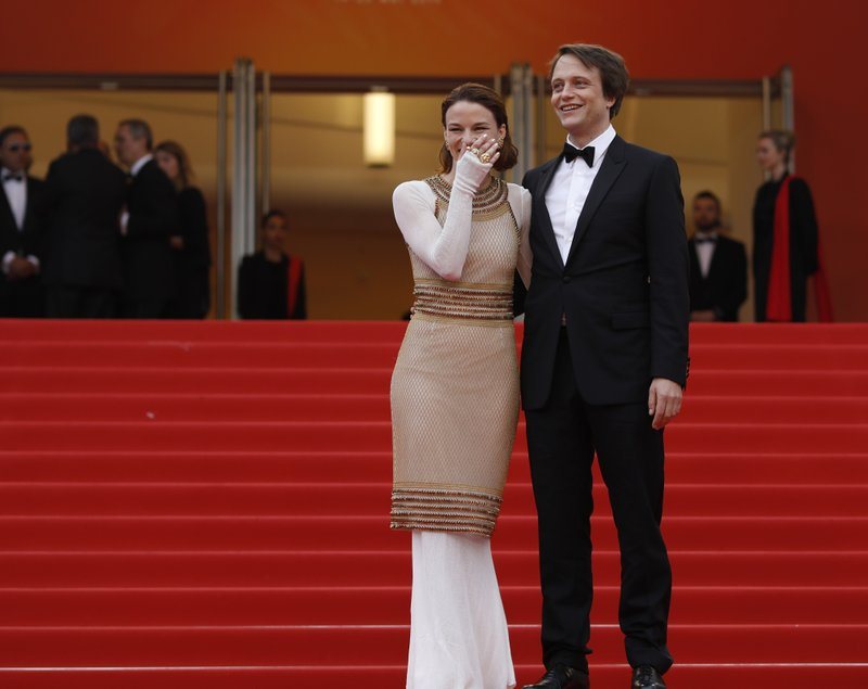 Actors August Diehl, right, and Valerie Pachner pose for photographers upon arrival at the premiere of the film 'A Hidden Life' at the 72nd international film festival, Cannes, southern France, Sunday, May 19, 2019. (AP Photo/Petros Giannakouris)