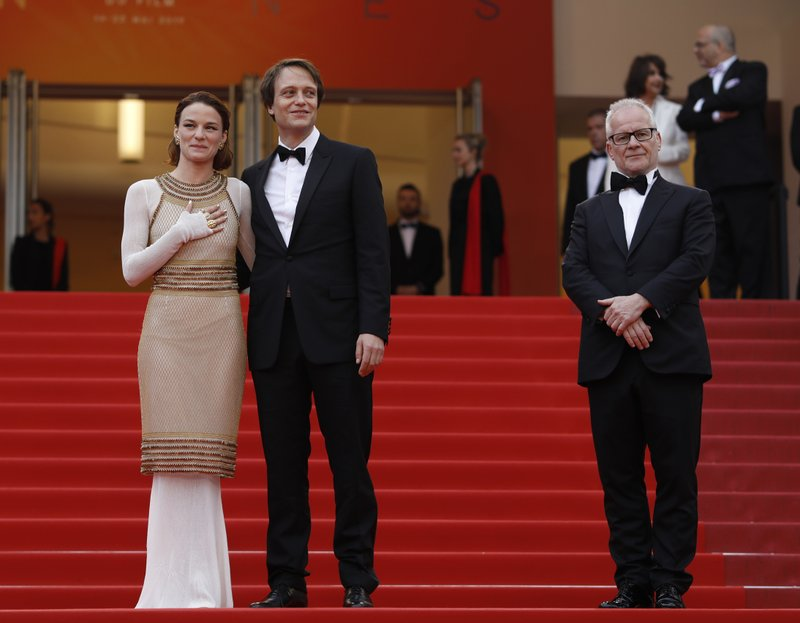 Actors August Diehl, centre, Valerie Pachner and festival director Thierry Fremaux pose for photographers upon arrival at the premiere of the film 'A Hidden Life' at the 72nd international film festival, Cannes, southern France, Sunday, May 19, 2019. (AP Photo/Petros Giannakouris)
