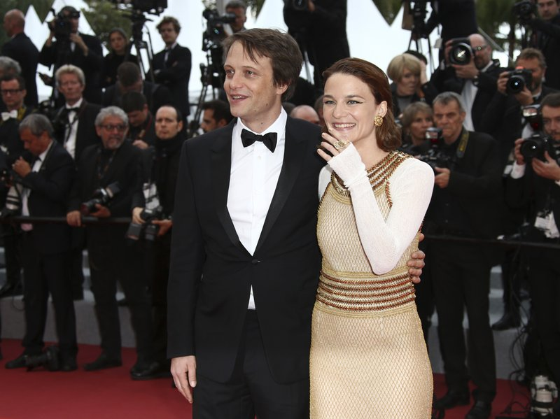 Actors August Diehl, left, and Valerie Pachner pose for photographers upon arrival at the premiere of the film 'A Hidden Life' at the 72nd international film festival, Cannes, southern France, Sunday, May 19, 2019. (Photo by Joel C Ryan/Invision/AP)