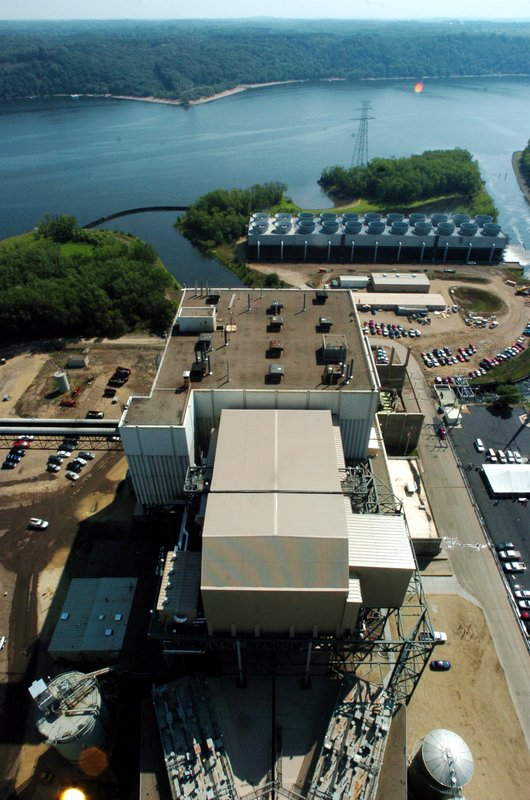 Xcel Energy 's Allen S. King power plant on the St. Croix River in Oak Park Heights, Minn., was rededicated Wednesday, July 25, 2007, after retrofitting with new pollution-control equipment. Xcel Energy said Monday, May 20, 2019 the Minneapolis-based utility plans to retire its two remaining coal plants in the Upper Midwest by 2030, a decade earlier than scheduled,  (Craig Borck/Pioneer Press via AP)