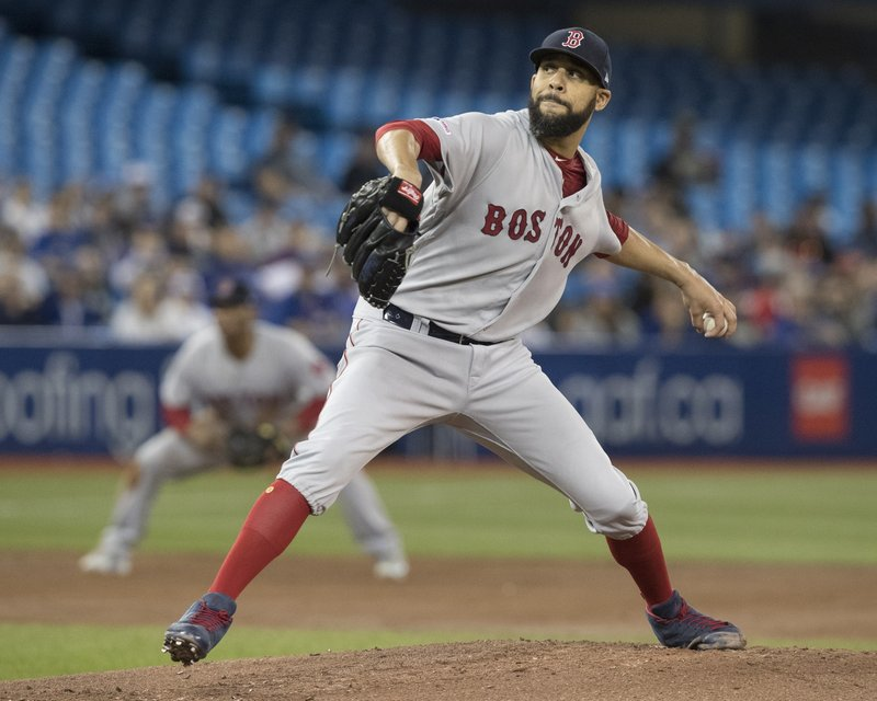 Boston Red Sox starting pitcher David Price throws against the Toronto Blue Jays during the first inning of their baseball game in Toronto, Monday, May 20, 2019. (Fred Thornhill/The Canadian Press via AP)