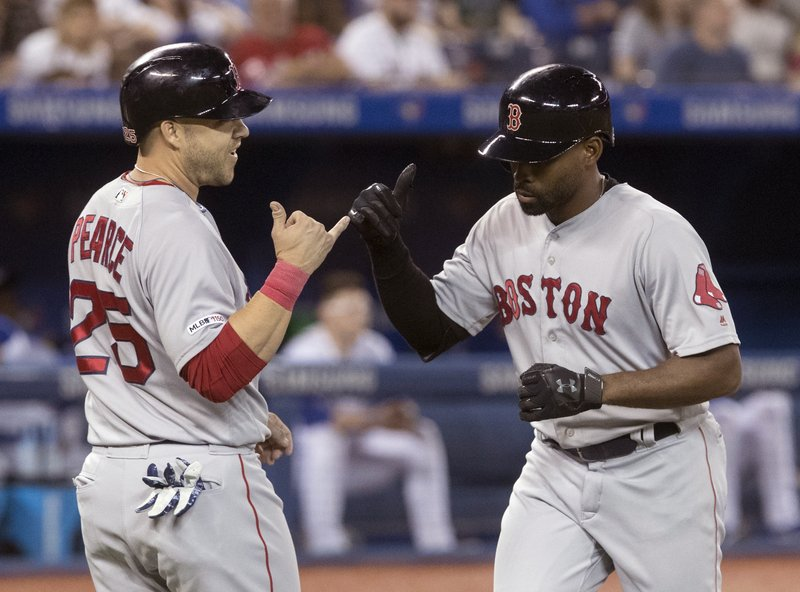 Boston Red Sox Jackie Bradley Jr., right, is greeted by teammate Steve Pearce after hitting a two-run home run against the Toronto Blue Jays in the sixth inning of a baseball game in Toronto, Monday, May 20, 2019. (Fred Thornhill/The Canadian Press via AP)