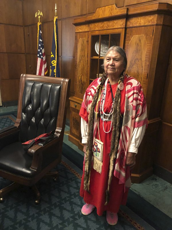 In this May 16, 2019 photo, Patricia Whitefoot, a member of the Yakama tribe from White Swan, Washington, poses for a photo in the state house in Salem, Ore. after Gov. Kate Brown signed a bill directing the state police to study how to improve criminal justice resources to solve cases of Native American women who have gone missing or been killed. Whitefoot's sister Daisy disappeared in 1987. The case was never solved. Whitefoot was involved in the effort to pass the bill in Oregon, and a similar one in Washington state earlier. (AP Photo/Andrew Selsky)