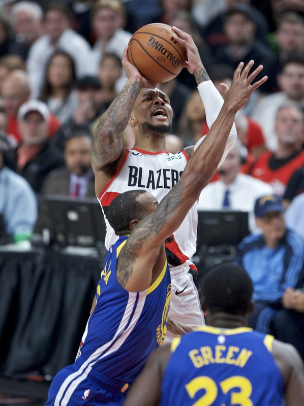 Portland Trail Blazers guard Damian Lillard, top, is fouled by Golden State Warriors guard Andre Iguodala during the first half of Game 3 of the NBA basketball playoffs Western Conference finals Saturday, May 18, 2019, in Portland, Ore. (AP Photo/Craig Mitchelldyer)