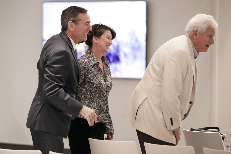 House Speaker Glen Casada, R-Franklin, left, Rep. Susan Lynn, R-Mount Juliet, center, wait for the start of a meeting of the House Republican Caucus at a hotel Monday, May 20, 2019, in Nashville, Tenn. The caucus met to discuss the future of Casada, who is ensnarled in a texting scandal. The caucus returned a 45-24 vote of no confidence for Casada. (AP Photo/Mark Humphrey)