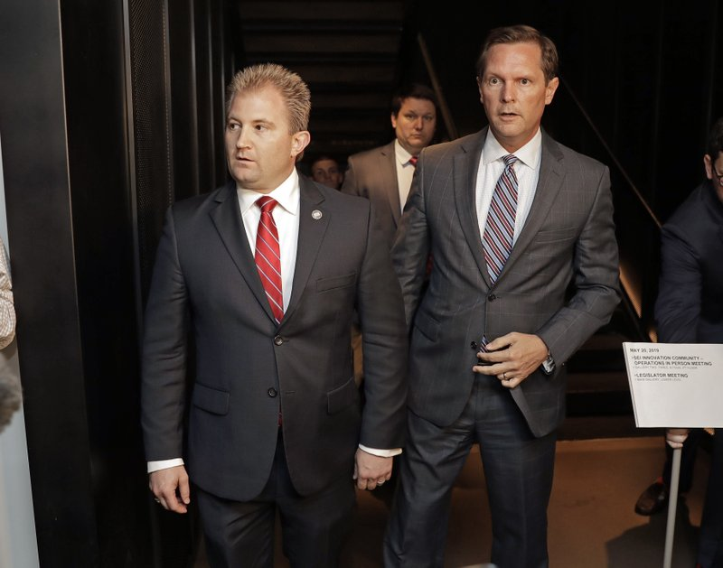 House Republican Majority Leader William Lamberth, R-Portland, left, and Rep. Cameron Sexton, R-Crossville, right, leave after the House Republican Caucus met to discuss the future of House Speaker Glen Casada, who is ensnarled in a texting scandal, Monday, May 20, 2019, in Nashville, Tenn. The caucus returned a 45-24 vote of no confidence for Casada. (AP Photo/Mark Humphrey)
