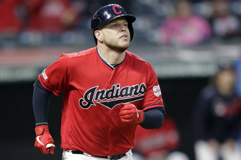 Cleveland Indians' Roberto Perez watches his solo home run off Oakland Athletics relief pitcher Yusmeiro Petit in the seventh inning of a baseball game, Monday, May 20, 2019, in Cleveland. (AP Photo/Tony Dejak)