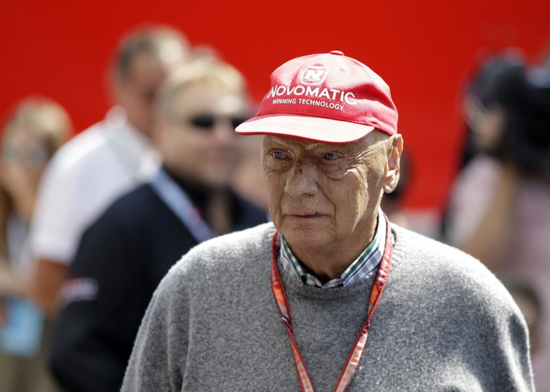 FILE - In this July 7, 2018, file photo, former Formula One World Champion Niki Lauda of Austria walks in the paddock before the third free practice at the Silverstone racetrack, Silverstone, England. Three-time Formula One world champion Niki Lauda, who won two of his titles after a horrific crash that left him with serious burns and went on to become a prominent figure in the aviation industry, has died. He was 70. The Austria Press Agency reported Lauda's family saying in a statement he